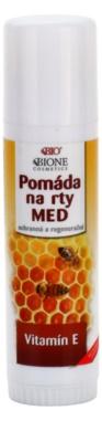 Bione Cosmetics Honey + Q10 pomada regeneradora y protectora para labios con vitamina E
