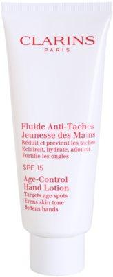 Clarins Body Specific Care fluid odmładzający do rąk przeciw przebarwieniom SPF 15