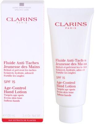 Clarins Body Specific Care verjüngendes Fluid für die Hände gegen Pigmentflecken SPF 15 1