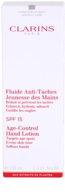 Clarins Body Specific Care омолоджуючий флюїд для рук проти пігментних плям SPF 15 2