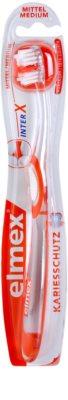 Elmex Caries Protection rövidfejű fogkefe közepes
