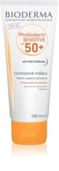 Bioderma Photoderm Sensitive захисне молочко для шкіри тіла та обличчя SPF 50+