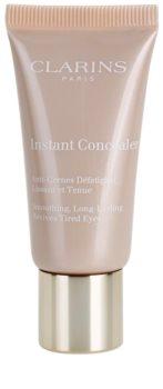 Clarins Face Make-Up Instant Concealer corrector de larga duración con efecto alisante