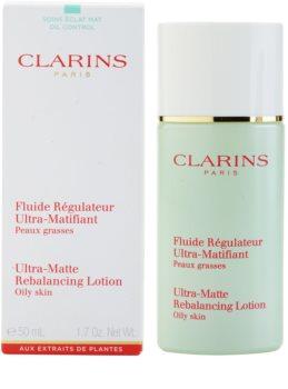 clarins truly matte fluide matifiant pour hydrater la peau et r duire l 39 apparence des pores. Black Bedroom Furniture Sets. Home Design Ideas