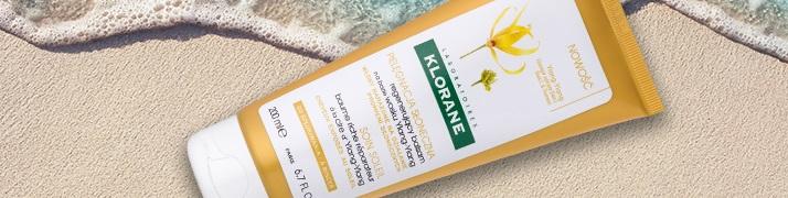 obnovujúci kondicionér pre vlasy namáhané slnkom Klorane Ylang-Ylang