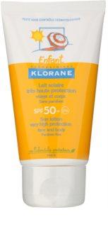Klorane Enfant schützende Milch für Gesicht und Körper SPF 50+