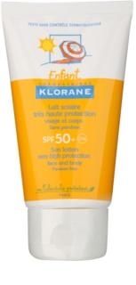 Klorane Enfant zaščitno mleko za telo in obraz SPF 50+