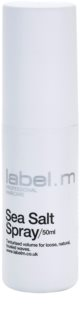 label.m Create spray con textura de playa